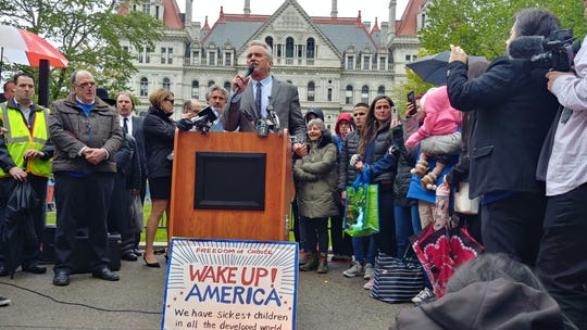 """Robert Kennedy Jr. speaking to a crowd of protestors in Albany on Tuesday. Kennedy questioned the safety of vaccines and claimed politicians and the media are in the pocket of """"big pharma."""""""