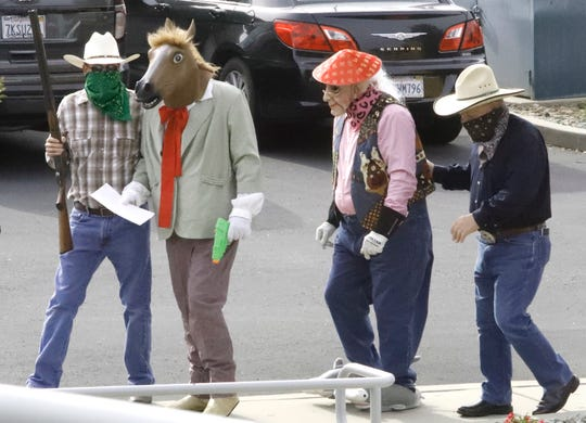 The Lone Stranger and Sidekick are escorted into Golden Valley Bank on Hemsted Drive on Tuesday morning, May 14, 2019, for the annual Rodeo Week robbery. The Asphalt Cowboys weren't able to stop the heist and what's more, let the duo get away.