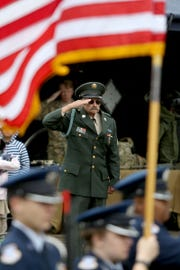 A veteran salutes the flag during the national anthem at an Armed Forces Day celebration at the Oregon State Capitol in Salem on May 14, 2019.