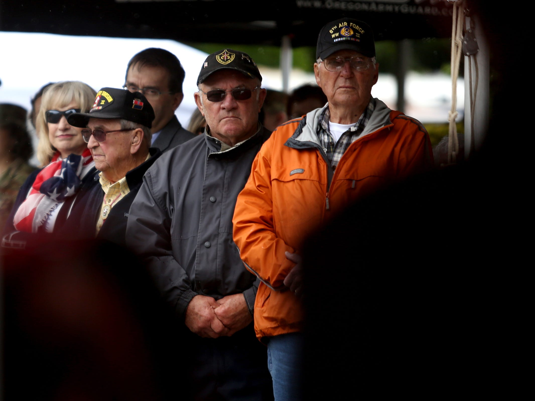 Veterans stand during a medley of military anthems during an Armed Forces Day celebration at the Oregon State Capitol in Salem on May 14, 2019.