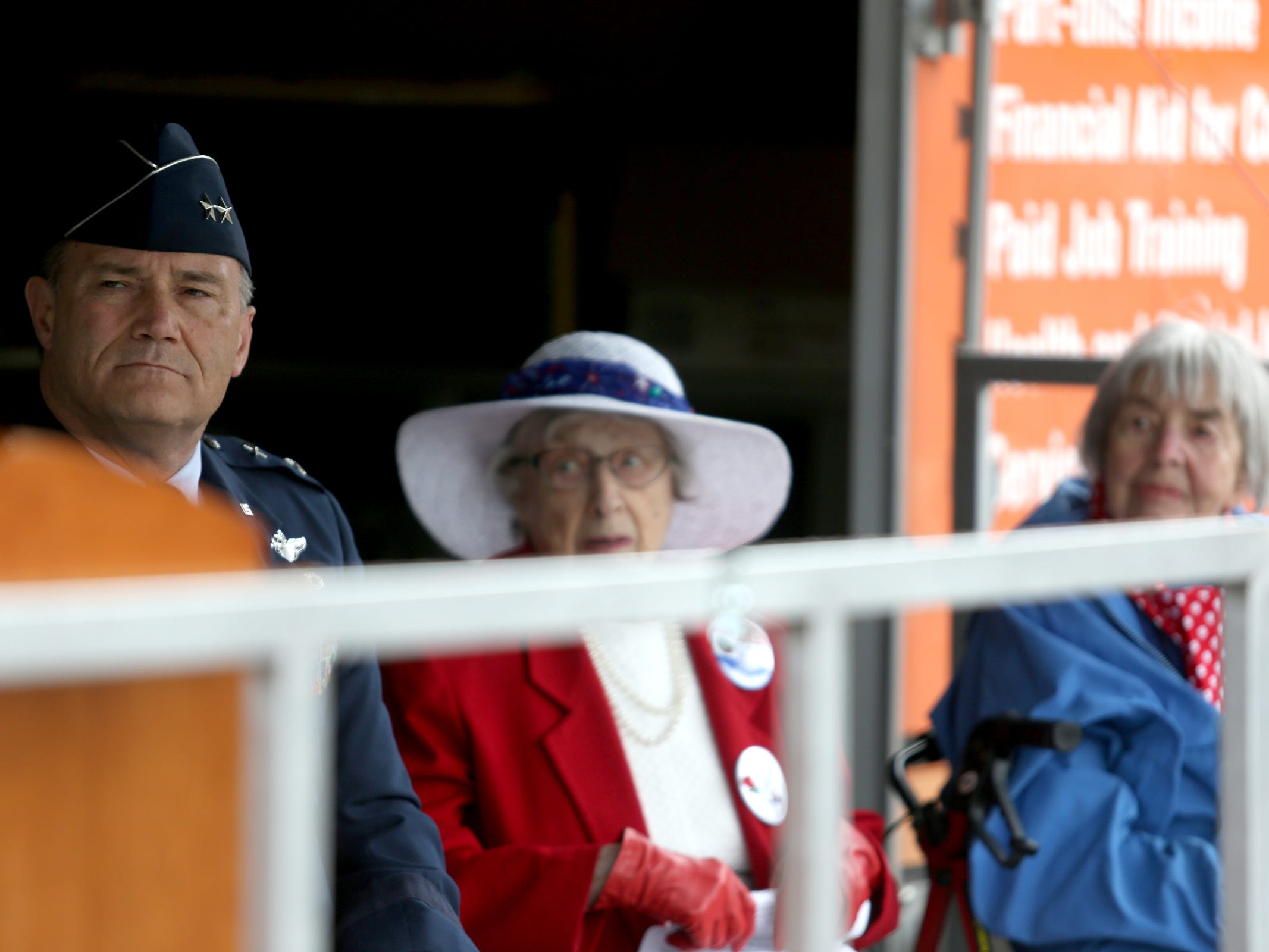 Michael E. Stencel, the Adjutant General of Oregon, sits with Joy Beebe, a World War II English war bride, and Rita Hathaway, a real-life Rosie the Riveter who worked in a Boeing plant during World War II, during an Armed Forces Day celebration at the Oregon State Capitol in Salem on May 14, 2019.
