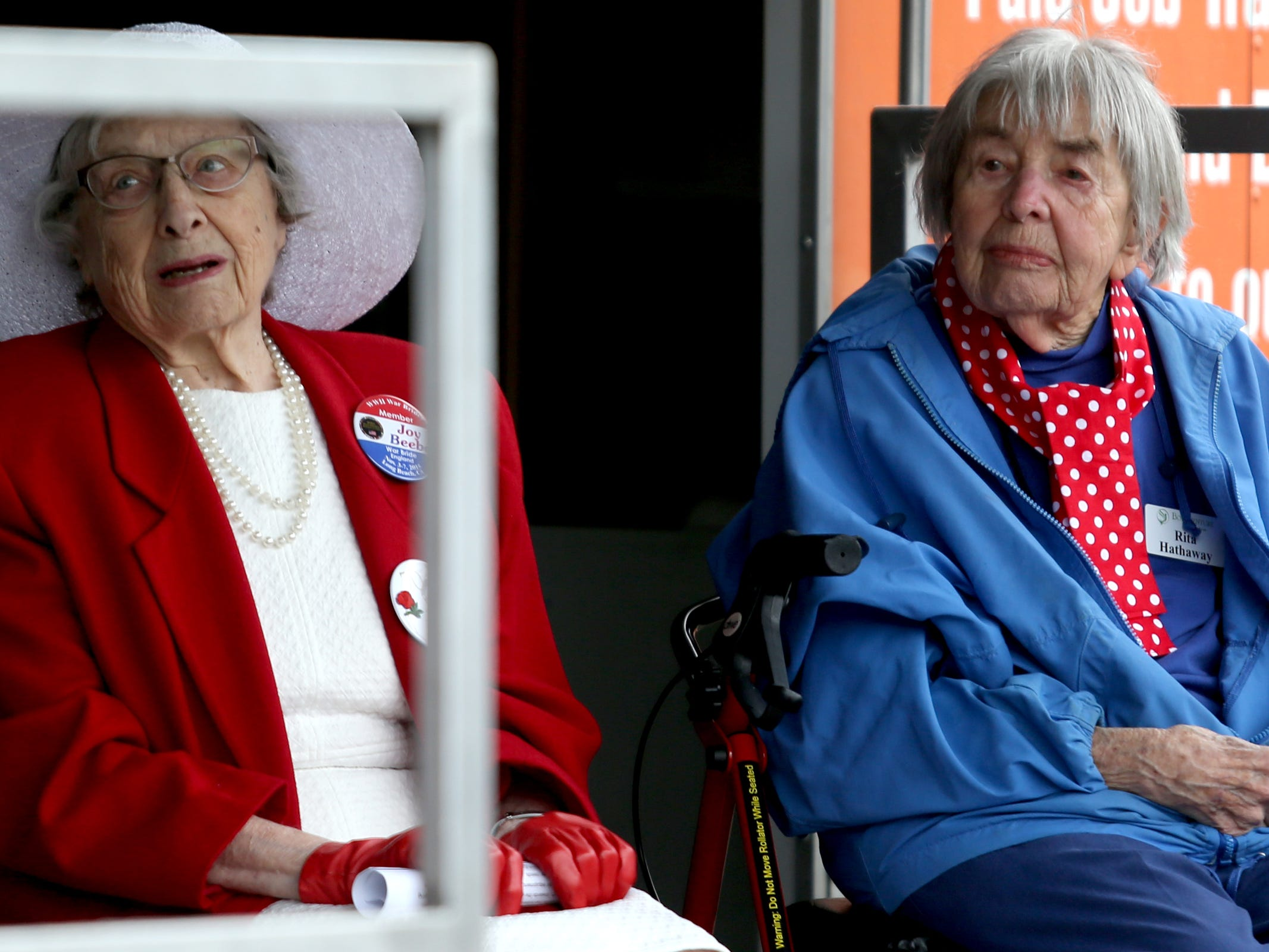 Joy Beebe, left, a World War II English war bride, and Rita Hathaway, a real-life Rosie the Riveter who worked in a Boeing plant during World War II, attend an Armed Forces Day celebration at the Oregon State Capitol in Salem on May 14, 2019.