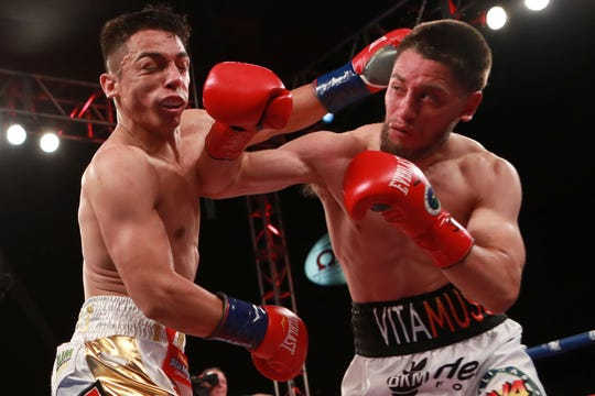 In his fight Friday night on Showtime, Ruben Villa (right) and Luis Alberto Lopez (left) threw nearly 1,400 punches combined.