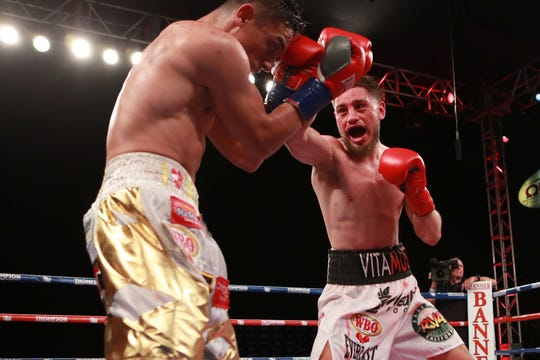 """Because it was his first 10-round fight against an aggressive opponent, the soreness for Ruben Villa (right) is a little more than usual. """"He definitely made me earn it,"""" he said of his opponent Lopez."""