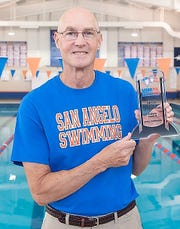San Angelo Central head swimming coach David Hague displays his NHSCA Boys Coach of the Year award for the 2018-19 season. Hague is retiring at the end of the school year after a 41-year career with the Bobcats.