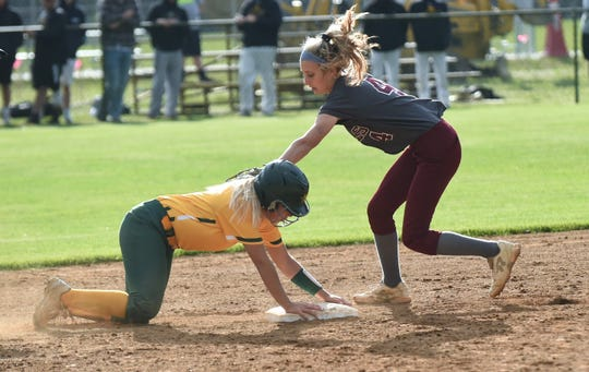 Snow Hill's Lauren Smith attempts a tag-out of Mardela's Sam Lanham in the 1A East playoffs on Tuesday, May 14, 2019.