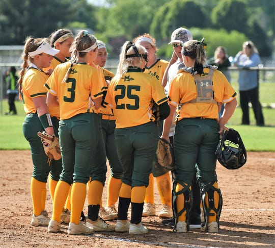 Mardela head coach Kory Shiles talks with his team in the 1A East playoffs on Tuesday, May 14, 2019.