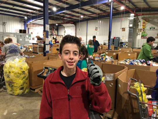 "Liam Boyle volunteers to help ""Stamp Out Hunger."""
