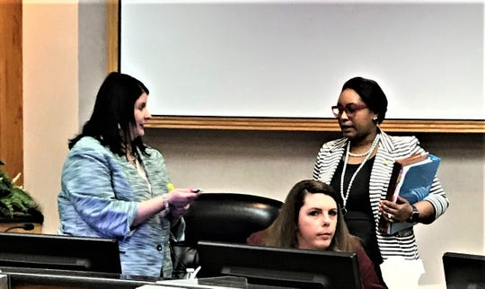 Assistant City Attorney Karen Strand speaking with her superior, City Attorney Mekisha Creal after a city council meeting May 13. Creal told Strand she's being reassigned to risk services Thursday. Also pictured is Danielle Farr Ewing who is set to replace Strand.