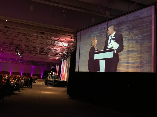 """Sioux Falls Mayor Paul TenHaken honors Teri Schmidt, executive director of the Sioux Falls Convention & Visitors Bureau, by declaring May 14 to be """"Teri Schmidt Day."""""""