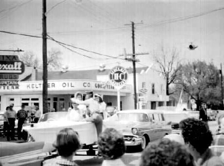 The Sucker Day Parade passes Keltner Oil Station. A vintage Sucker Days photo from the city of Nixa's collection.
