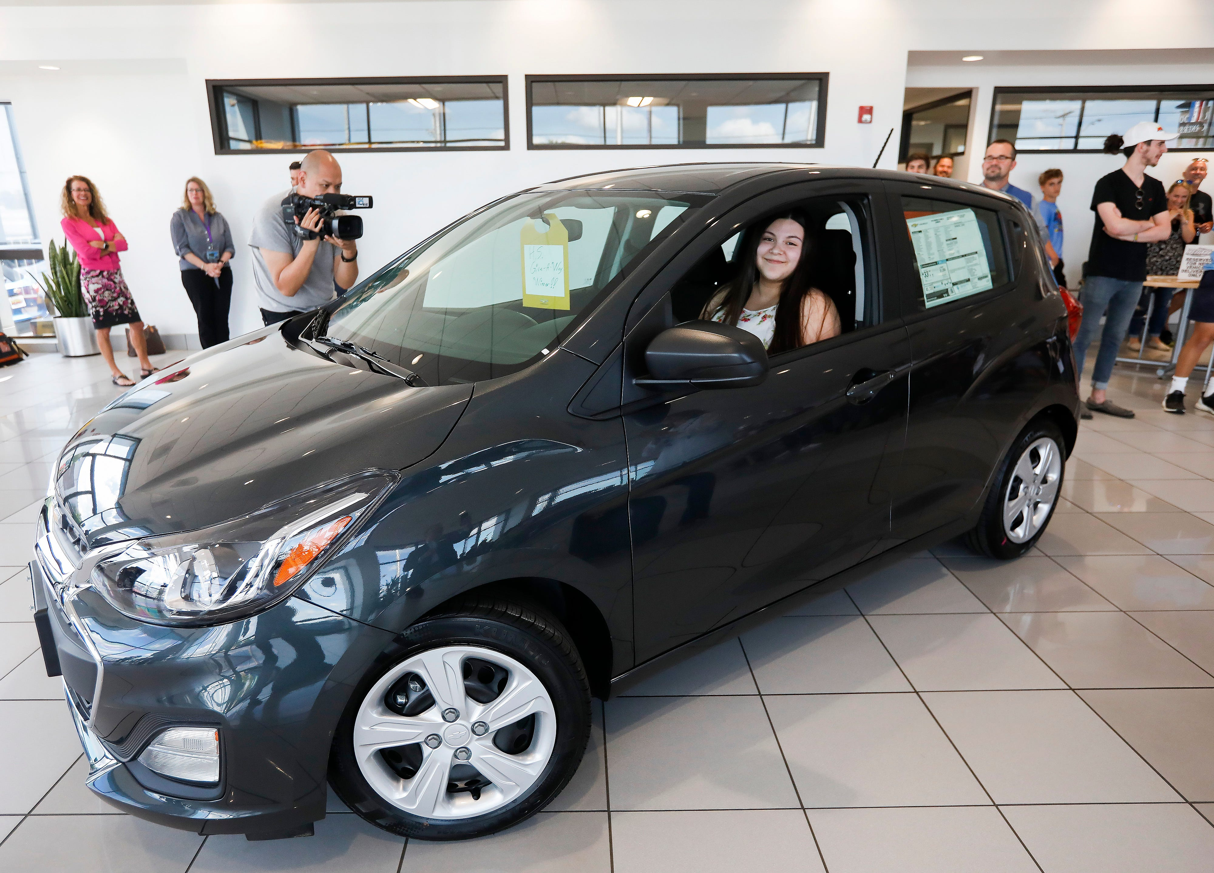 Marina Guevara, a recent graduate of Central High School, smiles after she won the first 2019 Chevy Spark from Reliable Chevrolet on Monday, May 14, 2019. Students from Springfield Public Schools who participated in Project Graduation, a safe and sober celebration following graduation, were eligible to win a car from the dealership in a drawing. In years past, Reliable Chevrolet gave away one car. This year they gave away two.