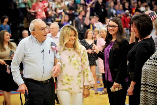 "World War II Merchant Marine veteran Cletis ""Buck"" Wilfong walks arm-in-arm with Glendale High School English teacher Julie Wead before an assembly Monday, May 13, 2019."