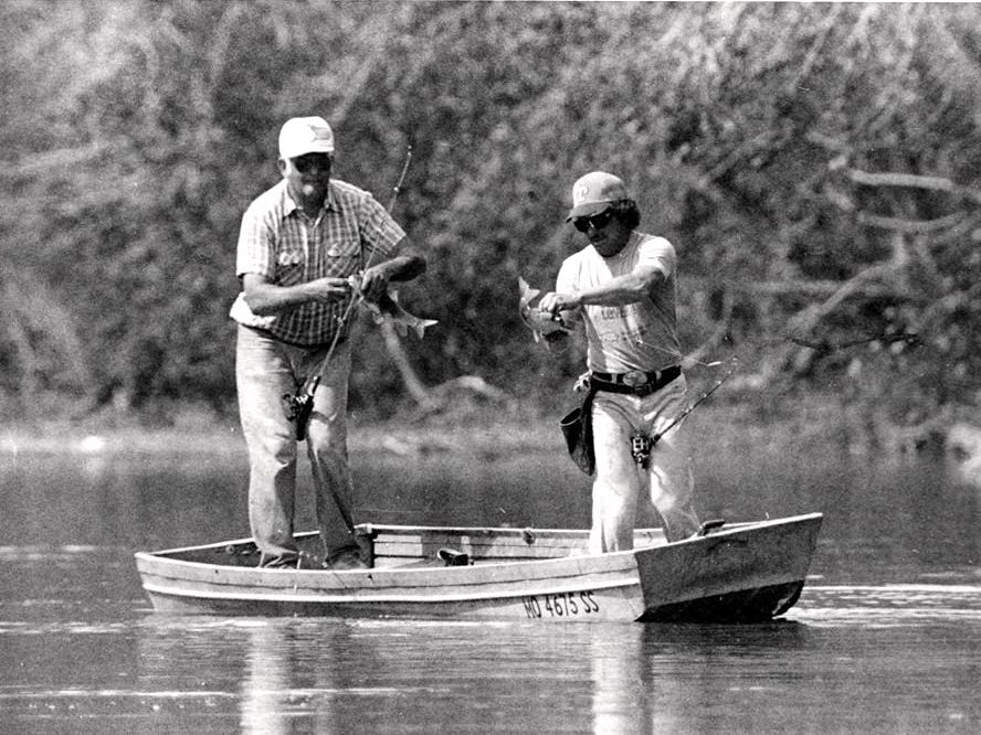 Rex Harp and Frank Harding grabbing suckers.  A vintage Sucker Days photo from the city of Nixa's collection.
