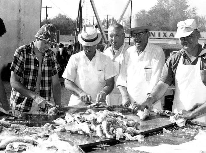 Sucker Day Filleters Bryan Norman, Pat Ward, Milton Wasson, Burl Pfander and  Robert Rice. A vintage Sucker Days photo from the city of Nixa's collection.