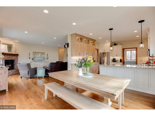 The spacious living room flows directly into the dining room and kitchen.