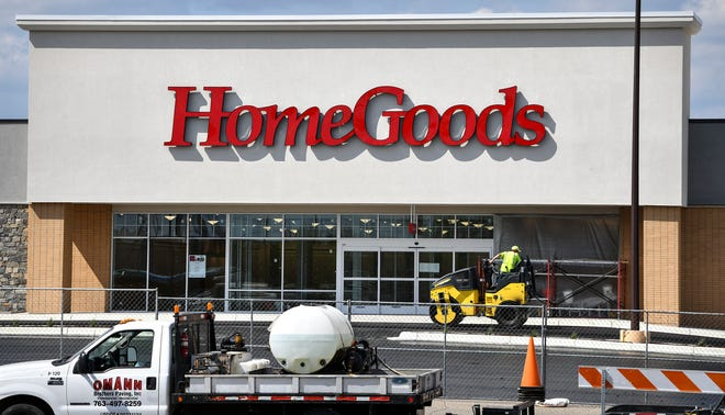 Paving continues in front of the HomeGoods storefront at Crossroads Center Tuesday, May 14, in St. Cloud. HomeGoods, Ulta Beauty and DSW Shoes are scheduled to open in the space formerly occupied by Sears.