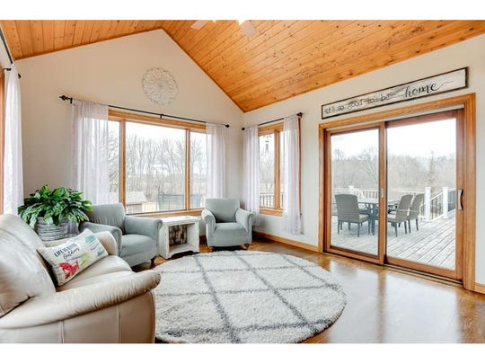 The main floor boasts a cozy four-season porch with a high vaulted ceiling; the perfect spot for a quiet cup of coffee or to sit and enjoy nature.