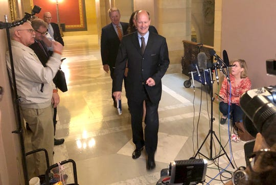 Republican Minnesota Senate Majority Leader Paul Gazelka walks past reporters on his way into budget talks with Democratic Gov. Tim Walz and Democratic House Speaker Melissa Hortman at the state Capitol in St. Paul, Minnesota, on Tuesday, May 14, 2019. (AP Photo/Steve Karnowski)