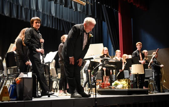 Gary Zwack, who has been band director at Technical High School since 1990, takes a bow at his final concert Monday, May 6 at Tech. Zwack is retiring at the end of the year.