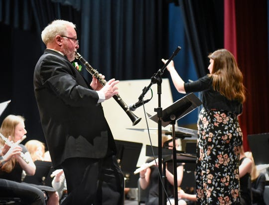 """Technical High School band director Gary Zwack performs with the Wind Ensemble's performance of """"Clarinet Polka"""" on Monday, May 6 at Tech. Conducting is Jessica Scherer, who will replace Zwack as band director next year."""
