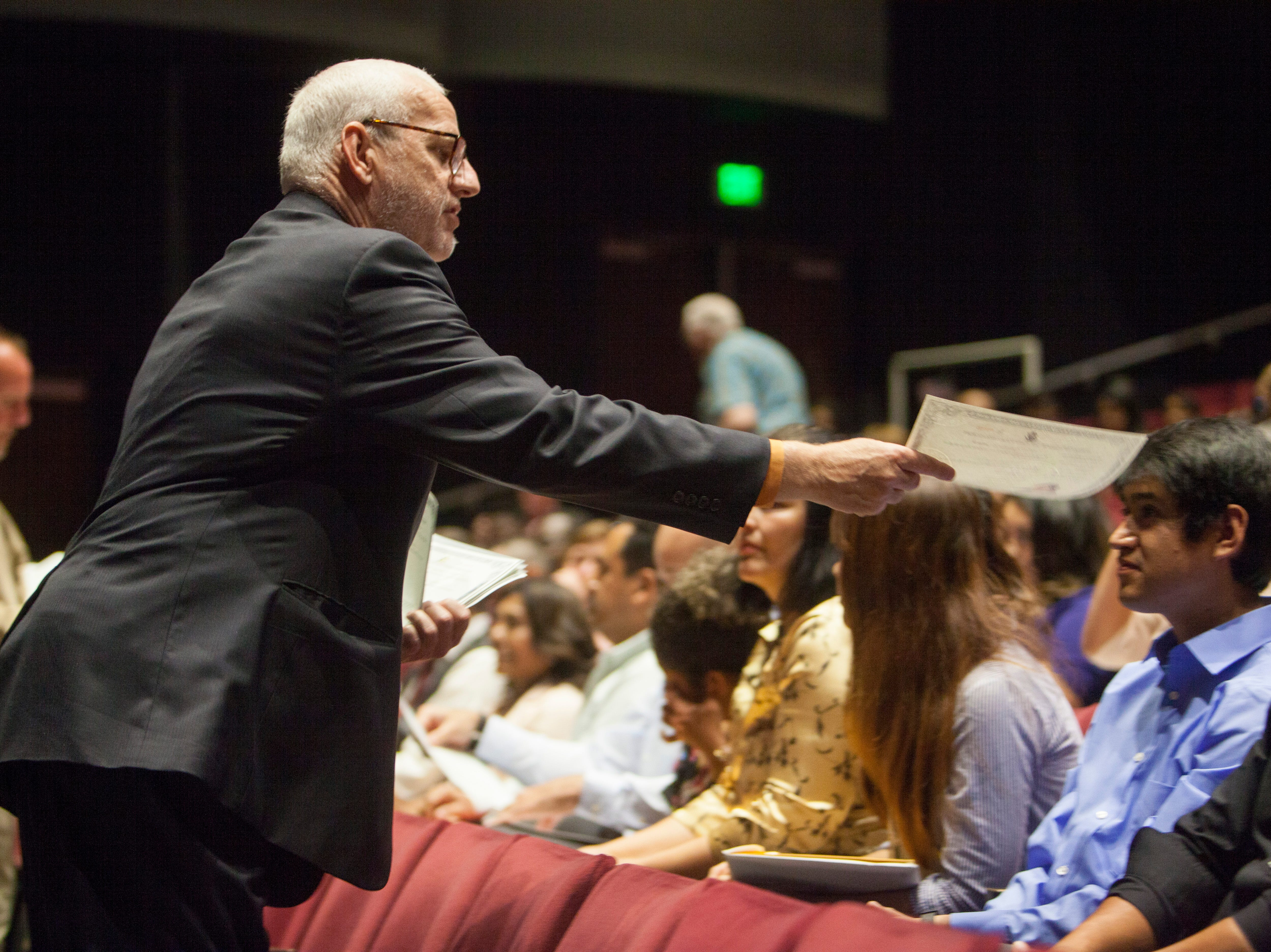 People gather at the Cox Auditorium to honor new U.S. citizens at a naturalization ceremony Tuesday, May 14, 2019.