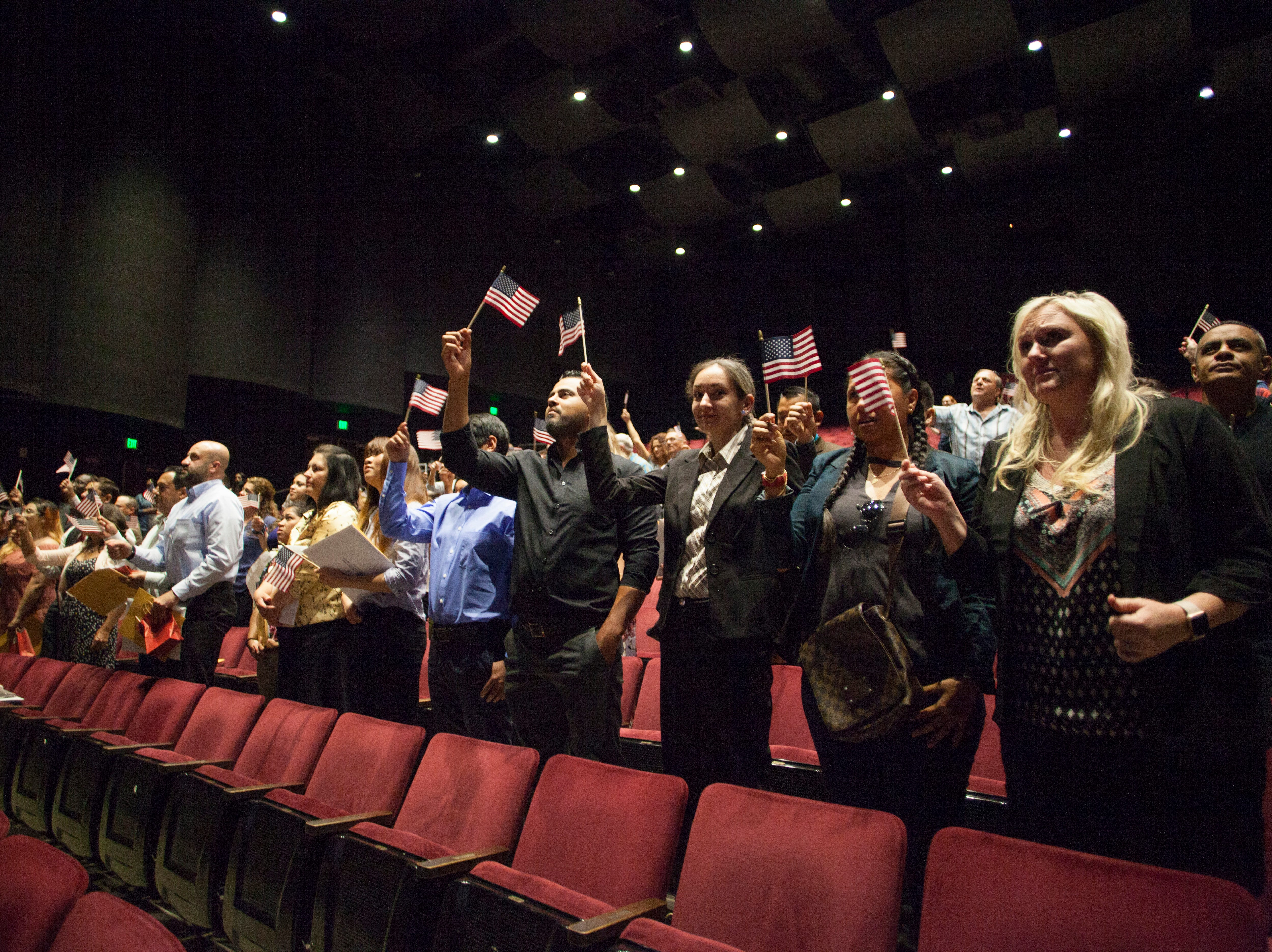 A crowd of people gathered at the Cox Auditorium at Dixie State University to recognize 31 new U.S. citizens sworn in during a naturalization ceremony Tuesday, May 14, 2019.