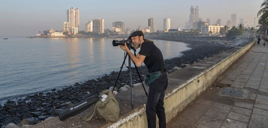 """FSU graduate Thomas Jackson shooting B-roll footage in Mumbai, India. for his full-length documentary, """"A Prayer for Compassion"""" which premiers Thursday in Tallahassee."""