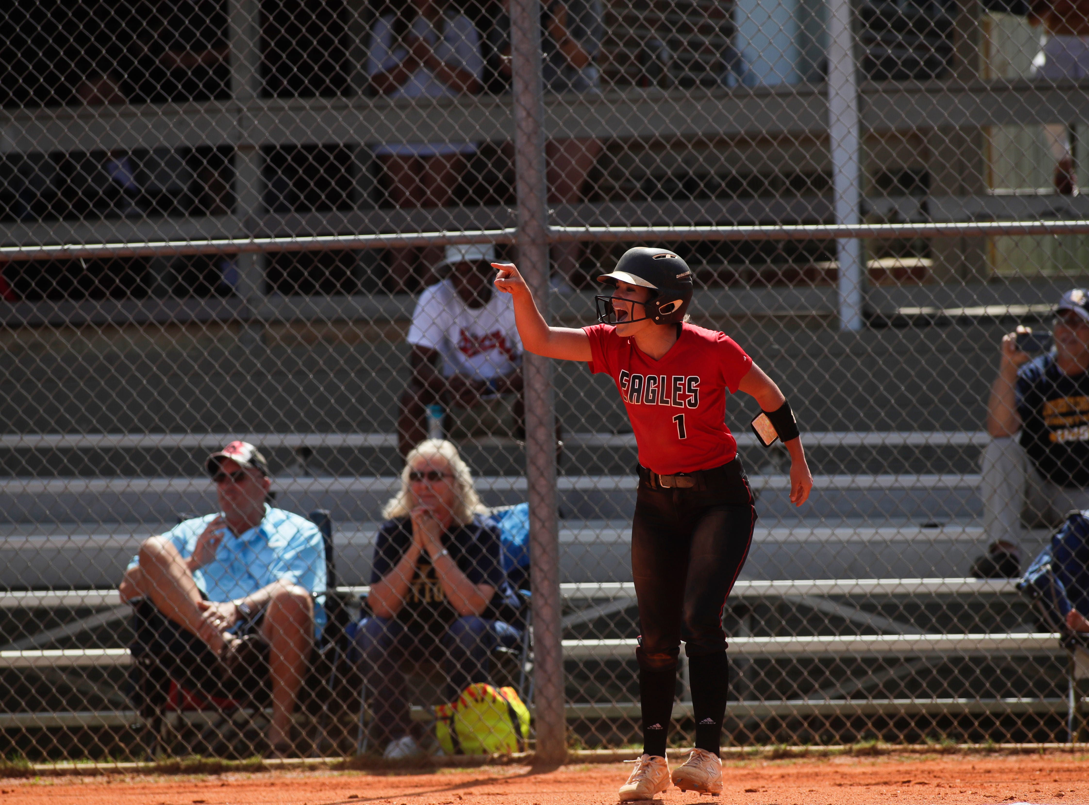 North Florida Christian's Chloe Culp (1) cheers on her teammates as she scores a run during the 1-3A regional final game between NFC and University Christian at NFC Tuesday, May 14, 2019. UC defeated NFC 16 to 11 to advance to the state tournament.
