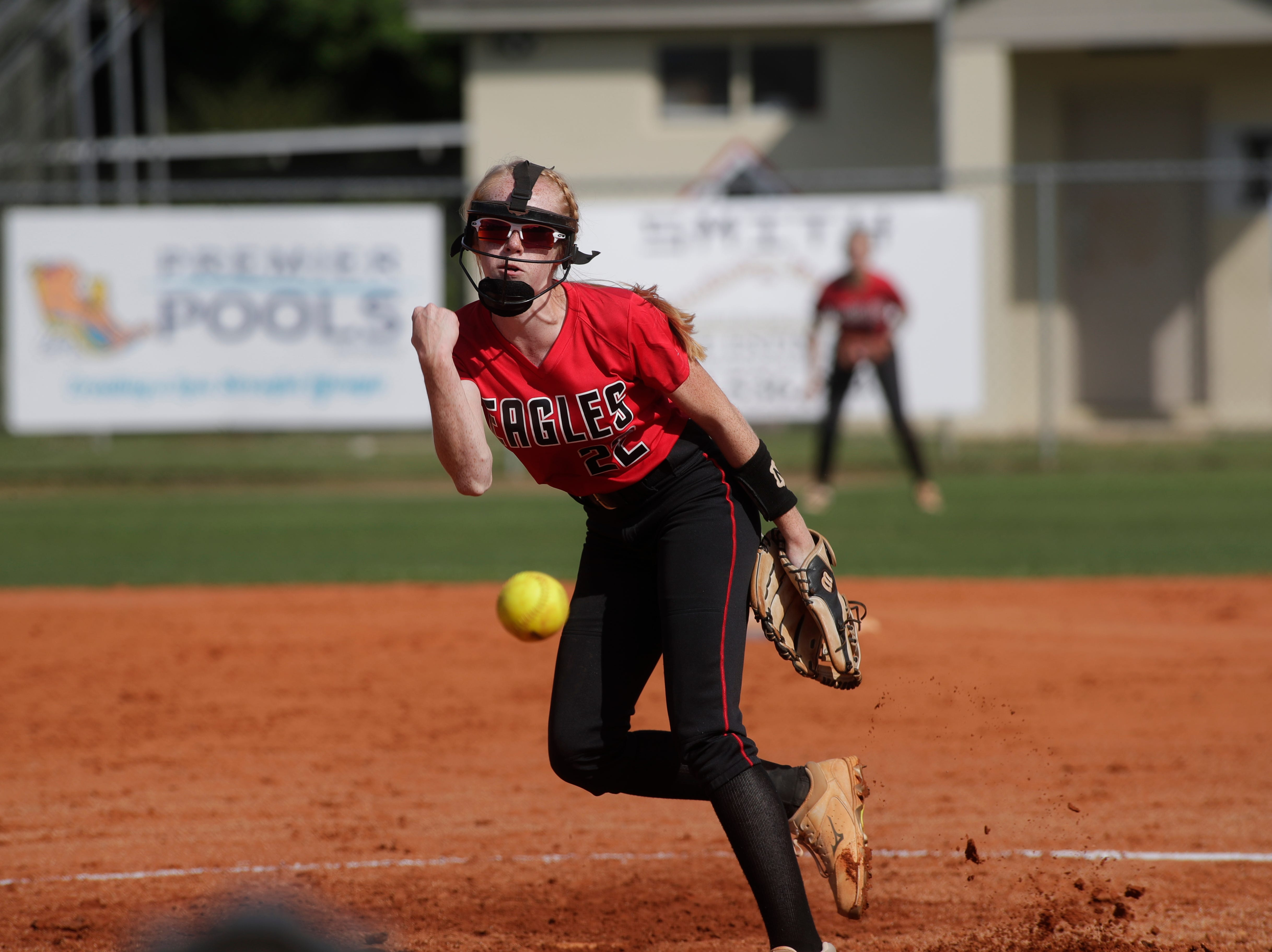 North Florida Christian's Maddie Mayo (22) throws a pitch during the 1-3A regional final game between NFC and University Christian at NFC Tuesday, May 14, 2019. UC defeated NFC 16 to 11 to advance to the state tournament.