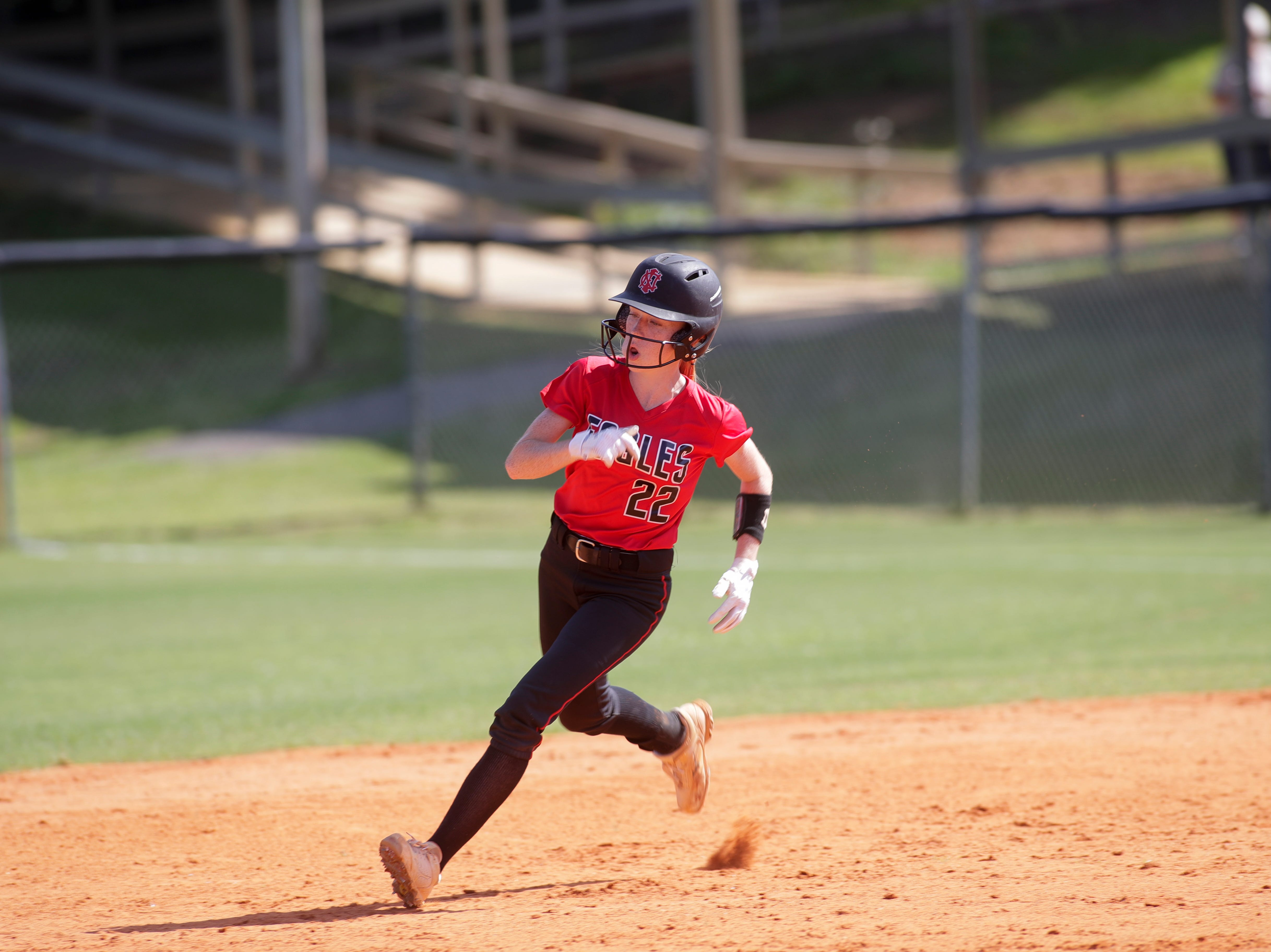 North Florida Christian's Maddie Mayo (22) rounds second during the 1-3A regional final game between NFC and University Christian at NFC Tuesday, May 14, 2019. UC defeated NFC 16 to 11 to advance to the state tournament.