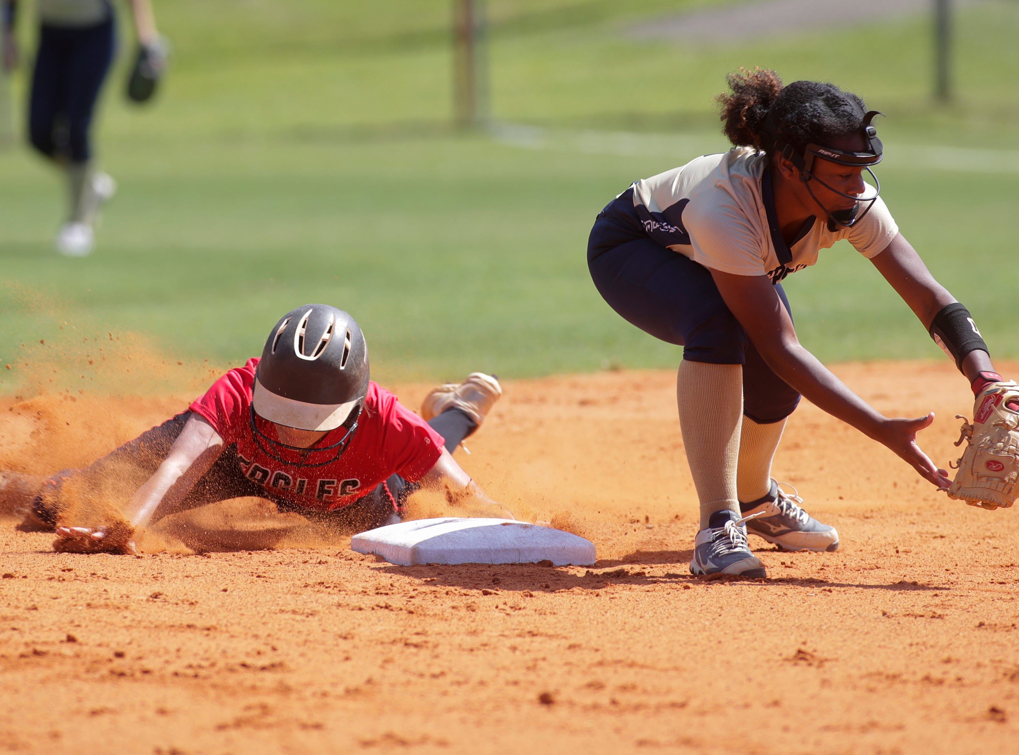 North Florida Christian's Chloe Culp (1) slides into second during the 1-3A regional final game between NFC and University Christian at NFC Tuesday, May 14, 2019. UC defeated NFC 16 to 11 to advance to the state tournament.