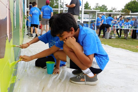 Lal Agarwal and his brother enjoyed pitching in on the mural.