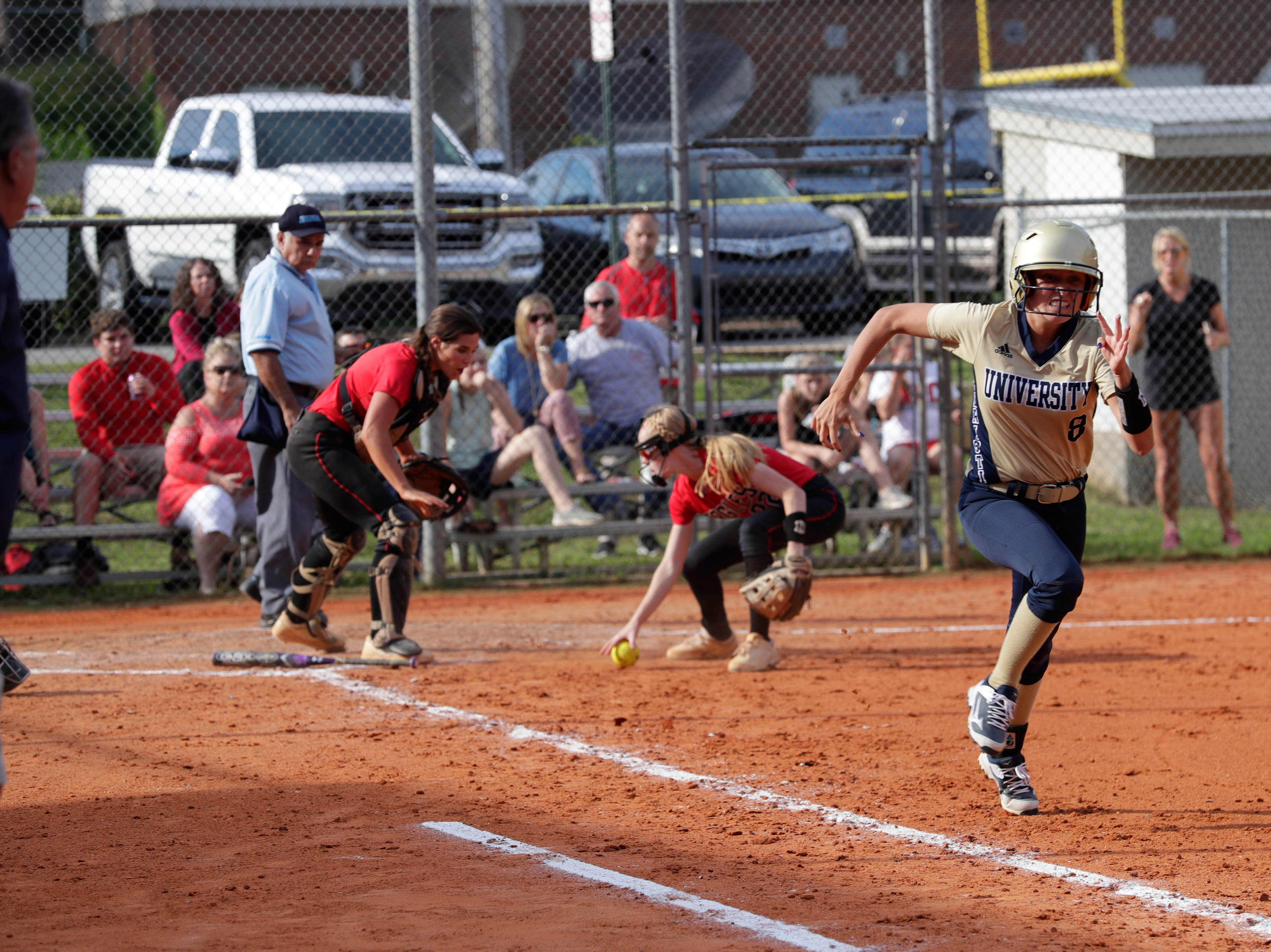 University Christian's Sway Tucker (8) runs to first as North Florida Christian's Chloe Culp (1) and Maddie Mayo (22) go for the ball during the 1-3A regional final game between NFC and University Christian at NFC Tuesday, May 14, 2019. UC defeated NFC 16 to 11 to advance to the state tournament.