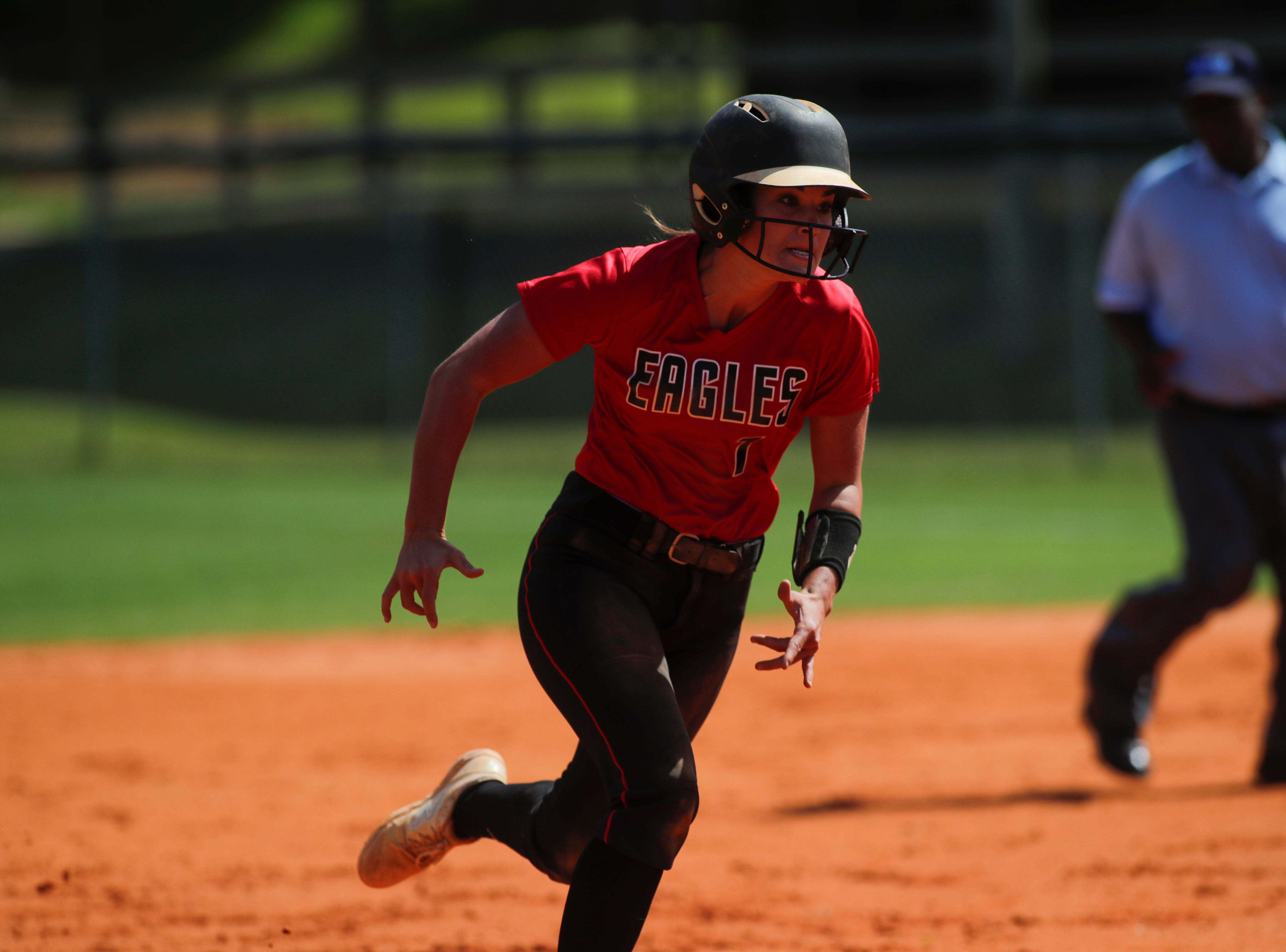 North Florida Christian's Chloe Culp (1) runs to third during the 1-3A regional final game between NFC and University Christian at NFC Tuesday, May 14, 2019. UC defeated NFC 16 to 11 to advance to the state tournament.