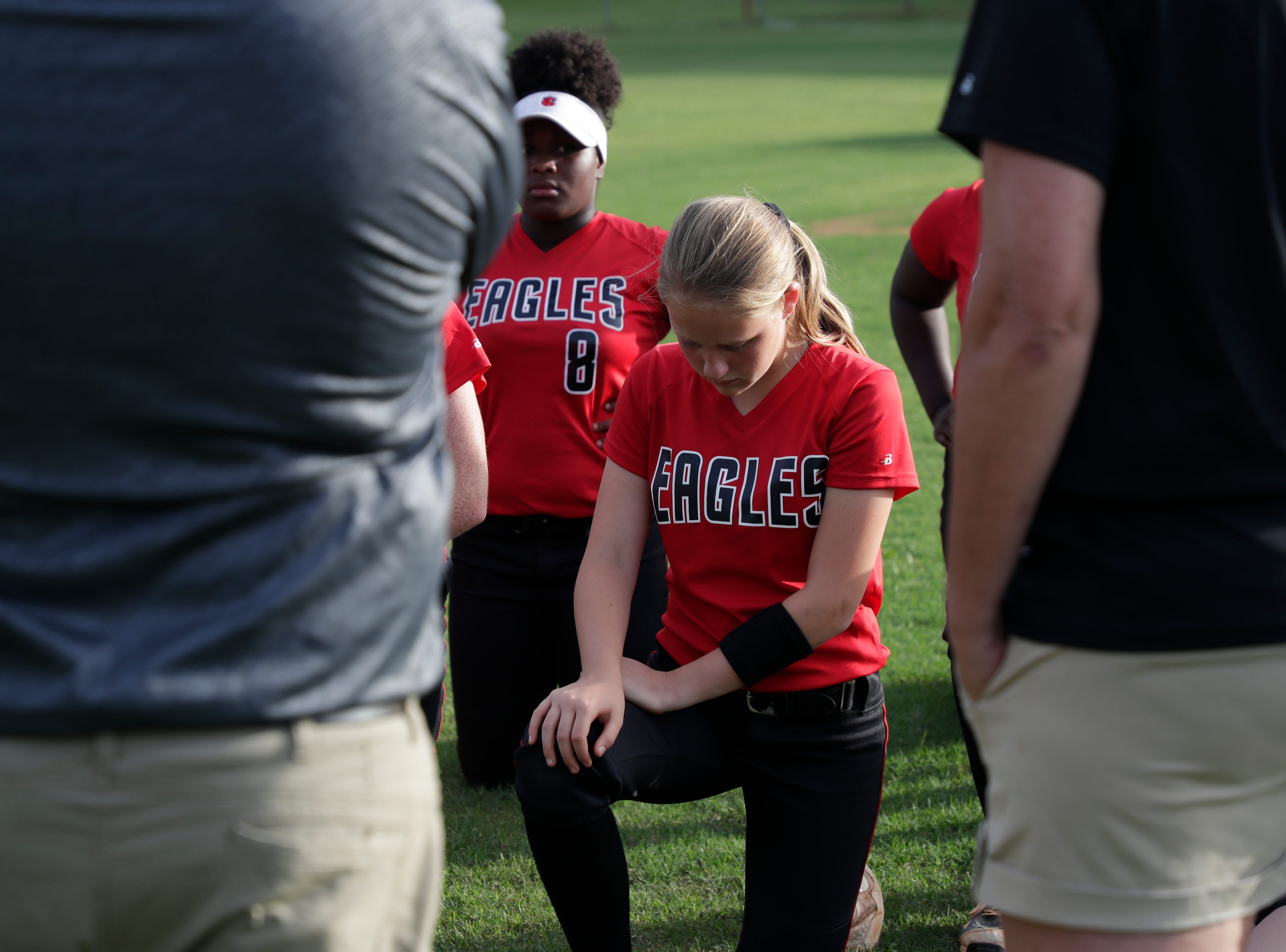 North Florida Christian's Emma Gorham (3) puts her head down as the team huddles after losing the 1-3A regional final game 16 to 11 to University Christian at NFC Tuesday, May 14, 2019.