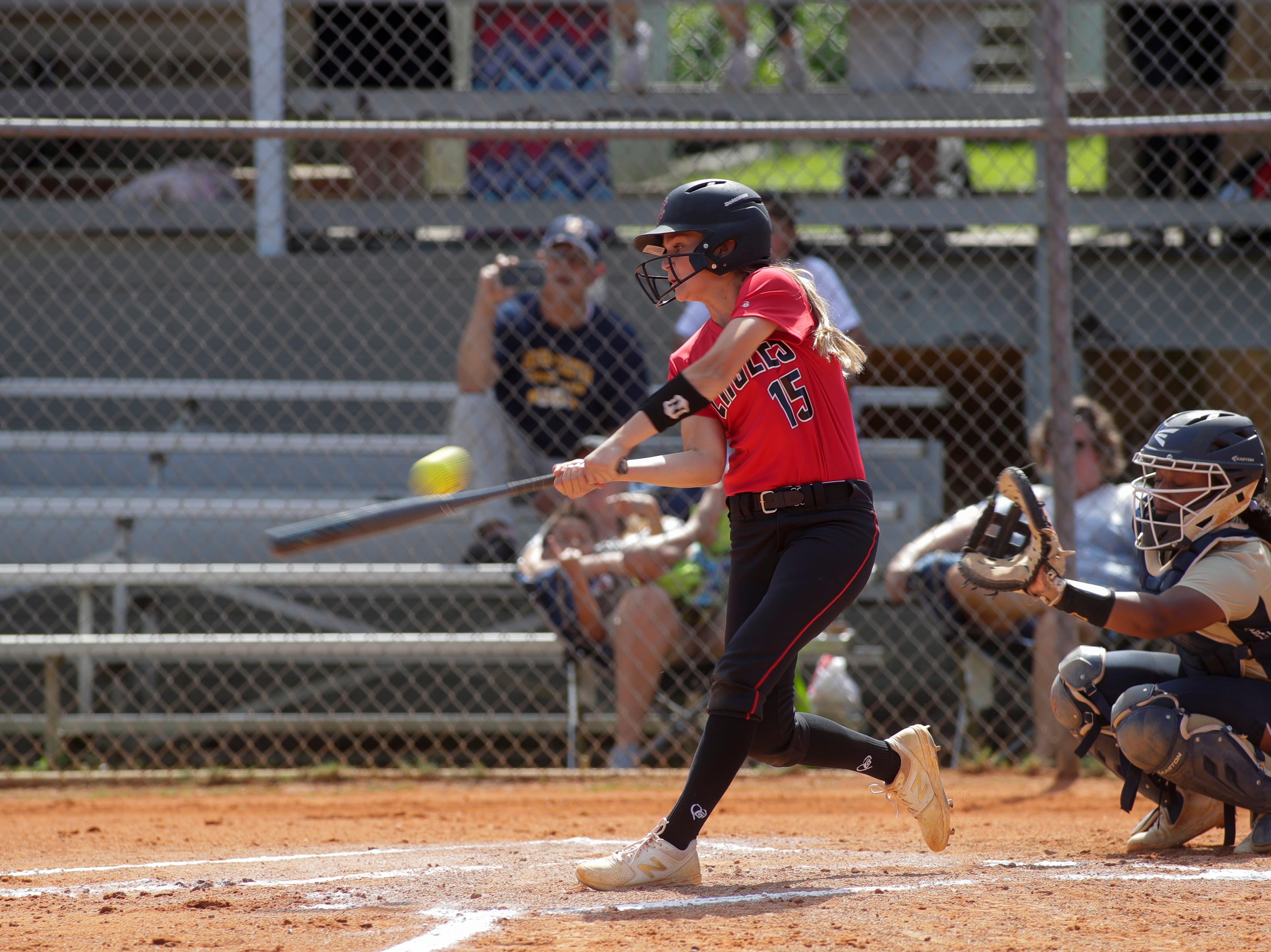North Florida Christian's Emma Brice (15) swings during the 1-3A regional final game between NFC and University Christian at NFC Tuesday, May 14, 2019. UC defeated NFC 16 to 11 to advance to the state tournament.