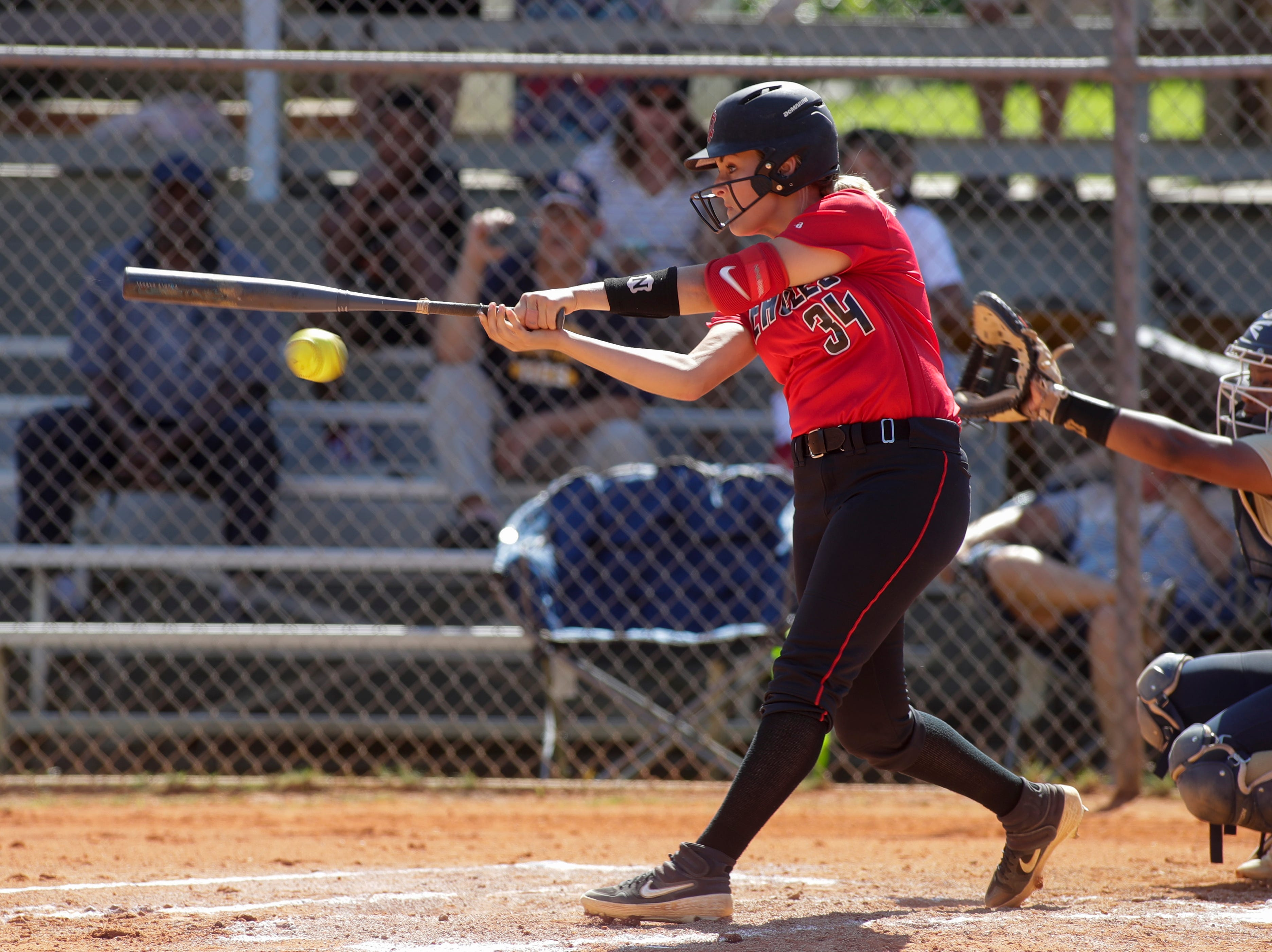 North Florida Christian's Ramsey Shiver (34) swings during the 1-3A regional final game between NFC and University Christian at NFC Tuesday, May 14, 2019. UC defeated NFC 16 to 11 to advance to the state tournament.