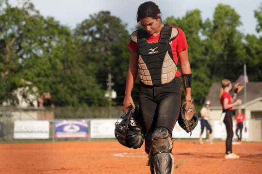 North Florida Christian's Chloe Culp (1) hangs her head as she makes her way back to home plate as her team blows the lead during the 1-3A regional final game between NFC and University Christian at NFC Tuesday, May 14, 2019. UC defeated NFC 16-11 to advance to the state tournament.