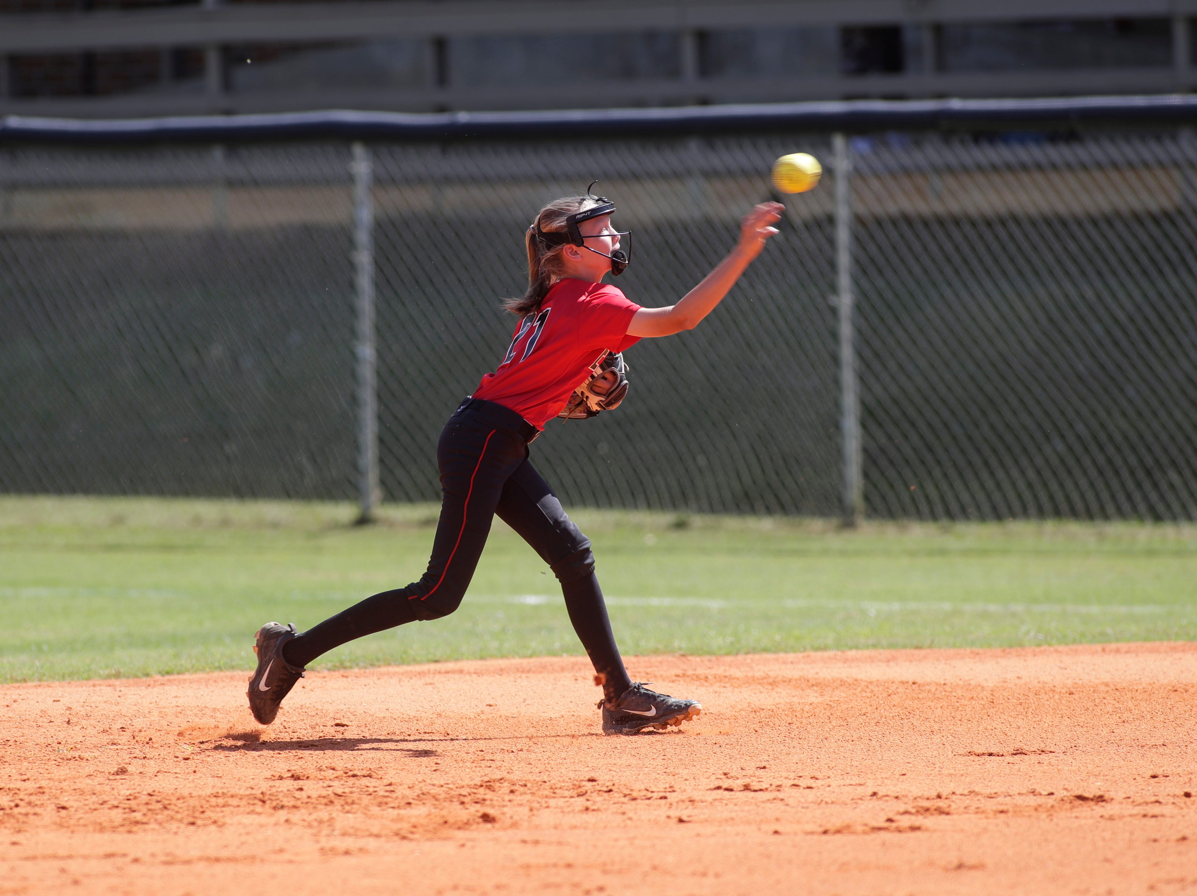 North Florida Christian's Madison Driggers (21) throws to first during the 1-3A regional final game between NFC and University Christian at NFC Tuesday, May 14, 2019. UC defeated NFC 16 to 11 to advance to the state tournament.