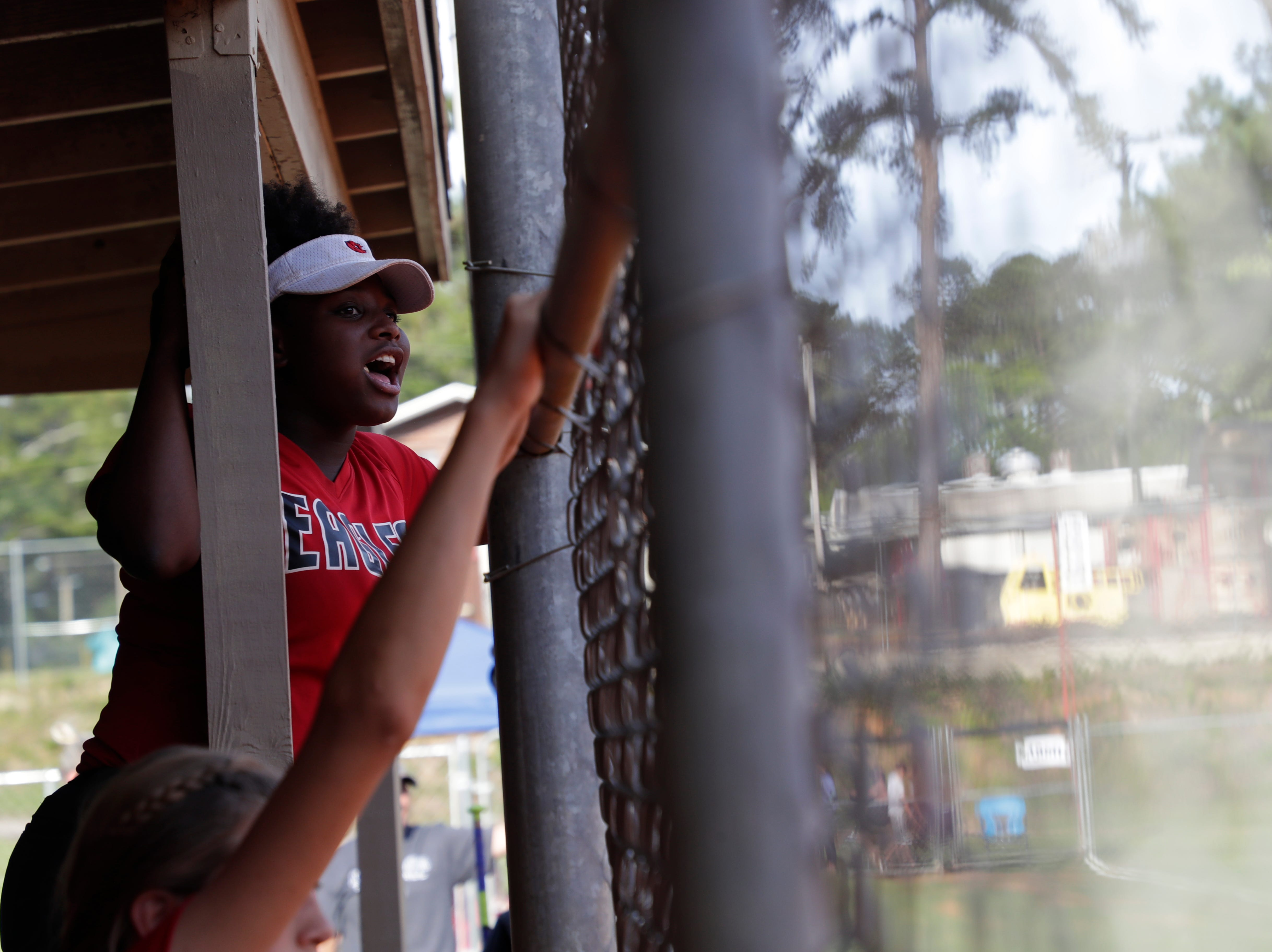 North Florida Christian's Alexis Howard (8) cheers her team on from the dugout during the 1-3A regional final game between NFC and University Christian at NFC Tuesday, May 14, 2019. UC defeated NFC 16 to 11 to advance to the state tournament.