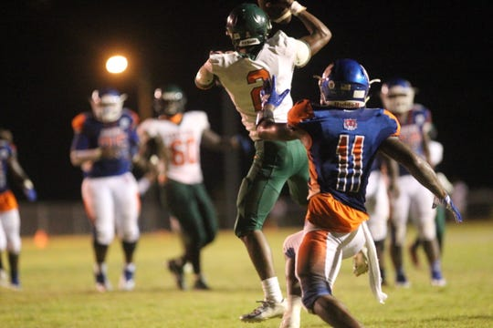 FAMU DRS junior LaKavian Williams records an interception during a game at Jefferson County last year.