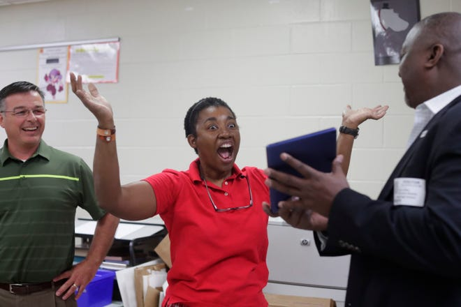 Dr. Marilyn Proctor-Givens, a teacher at Lincoln High School, center, is surprised by Dr. Allen Burch, principal at Lincoln, left, and Dave Wiltz, vice president of Sales at PCM-G,  when they tell Proctor-Givens she won the Grand Technology Prize valued at over $8,000 Tuesday, May 14, 2019. The school was also awarded Acer Chromebooks and tablets.