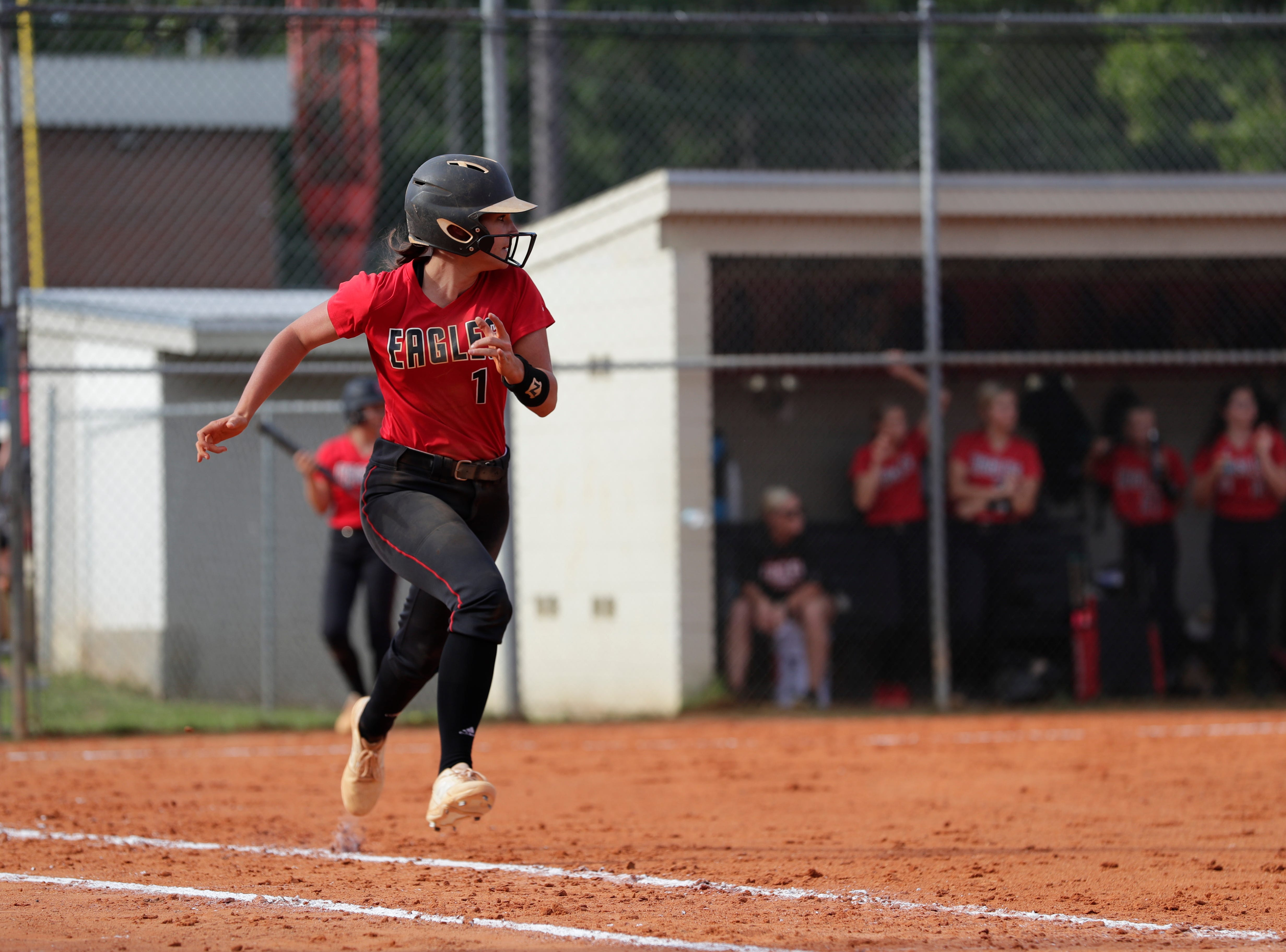 North Florida Christian's Chloe Culp (1) runs to first during the 1-3A regional final game between NFC and University Christian at NFC Tuesday, May 14, 2019. UC defeated NFC 16 to 11 to advance to the state tournament.