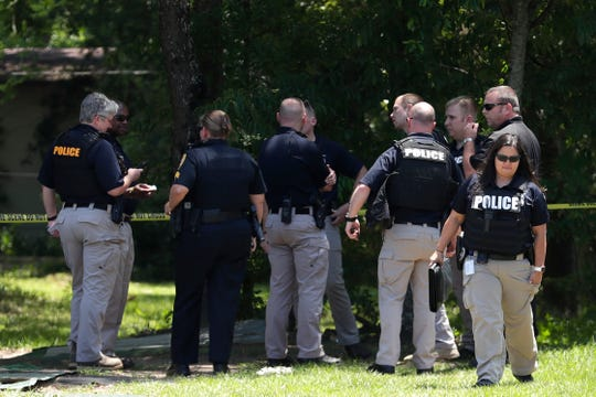 Police gather to talk about a shooting which occurred at the intersection of Gibbs Drive and Alice Jackson Lane near Oakland Cemetery in which the victim later died Tuesday, May 14, 2019.