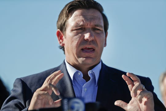 In this Jan. 29, 2019 file photo, Gov. Ron DeSantis speaks about his environmental budget at the Everglades Holiday Park during a new conference in Fort Lauderdale, Fla. Russian hackers gained access to voter databases in two Florida counties ahead of the 2016 presidential election, DeSantis said at a news conference Tuesday, May 14. DeSantis said the hackers didn't manipulate any data and the election results weren't compromised. He and officials from the Florida Department of Law Enforcement were briefed by the FBI and Department of Homeland Security on Friday, May 10.