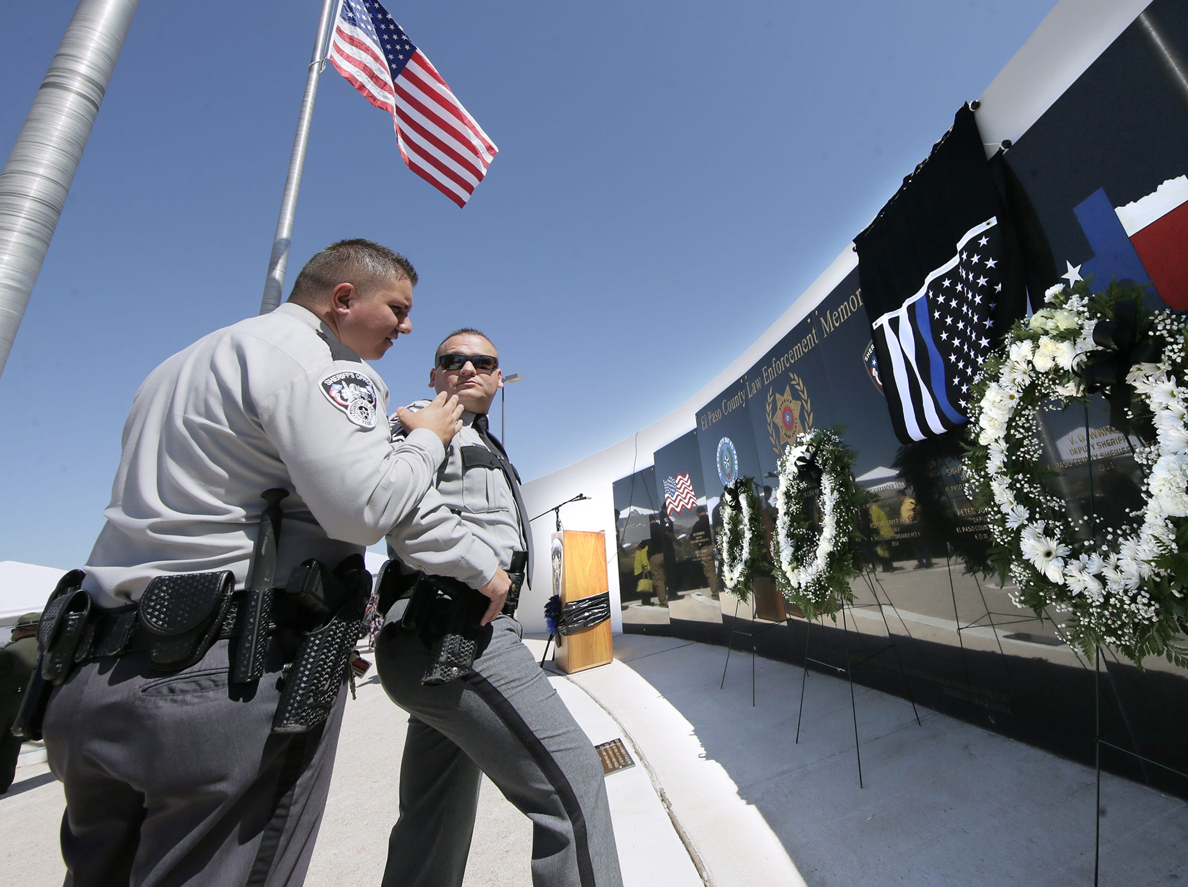 Detectives Darrell Rackley and James Nance reflect on their friendship with Deputy Peter Herrera after his name was revealed Tuesday, May 14, 2019, on the County Law Enforcement Memorial at the Sheriff's Office's headquarters in East El Paso.