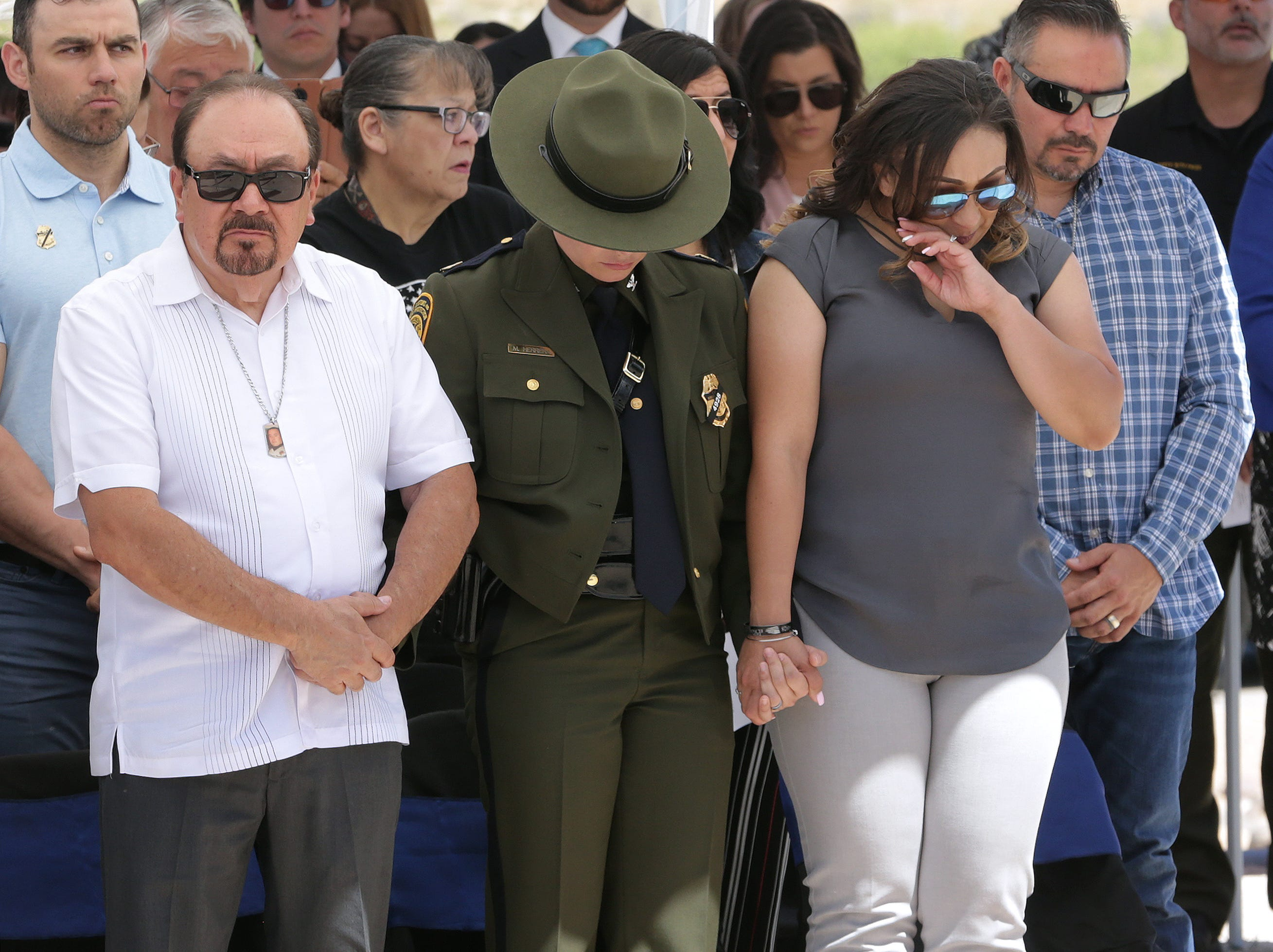 The El Paso County Sheriff's Office held its annual memorial Tuesday, May 14, 2019, at its headquarters in east El Paso. Deputy Peter Herrera's name was added to the County Law Enforcement Memorial this year after he was shot and killed during a traffic stop in San Elizario. Herrera's father, Luis Herrera, and widow, Ashley Herrera, react after unveiling his name.
