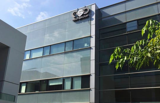 """This 2016 file photo shows the logo of the Israeli NSO Group company on a building where they had offices in Herzliya, Israel. Spyware crafted by a sophisticated group of hackers-for-hire took advantage of a flaw in the popular WhatsApp communications program to remotely hijack dozens of phones, the company said late Monday. The Financial Times identified the actor as Israel's NSO Group, and WhatsApp all but confirmed the identification, describing hackers as """"a private company that has been known to work with governments to deliver spyware."""