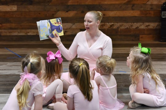 Rachel Epps, manager and teacher of Once Upon A Ballet in Spartanburg, reads a book based on the Disney movie Tangled to the girls in a creative ballet class at the Spartanburg Athletic Club on Thursday, April 18, 2019.